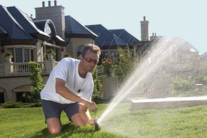 Man adjusting sprinkler head