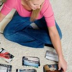 Woman sorting photos to find images of damaged house