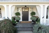 White porch curtains with greenery