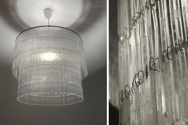 A chandelier made out of recycled plastic spoons