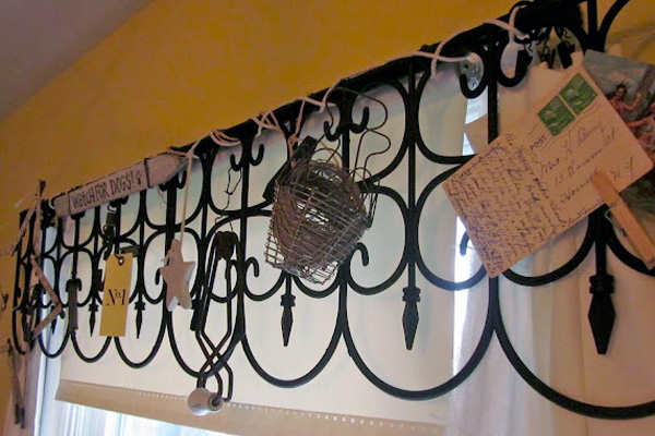 An iron fence reused as a valance