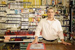 Man behind the counter at a tool cooperative