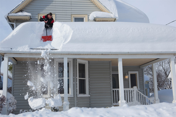 Heavy snow on top of a home