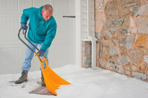 Man shoveling snow in his driveway