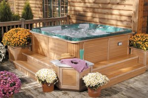Spa installed on a deck behind a house