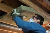 man-installing-attic-insulation-roxul
