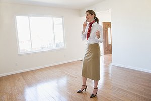 Woman walking through home one last time