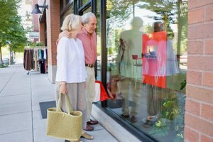 Couple window shopping in a walkable community
