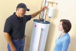Turning down conventional hot water heater's thermostat