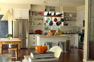Dark wood floor in white kitchen