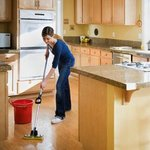 Woman cleaning kitchen with green products