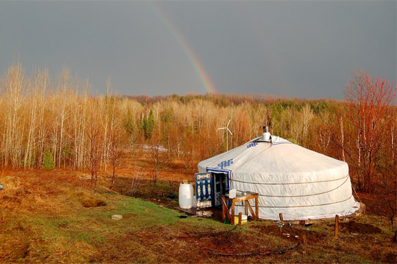Off the Grid Yurt with Rainbow in Background | Yurt Houses