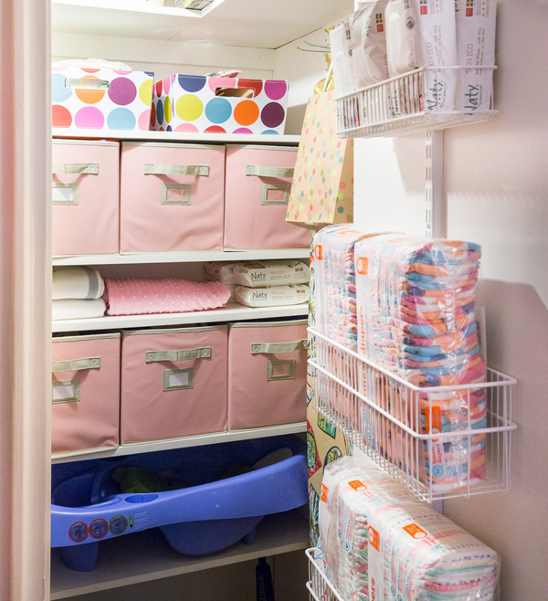 Toys are stored in fabric boxes in this children's closet