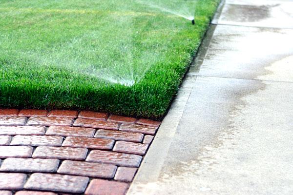 Watering a sidewalk
