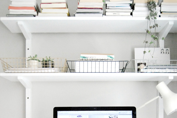 Home office with paperwork on shelves
